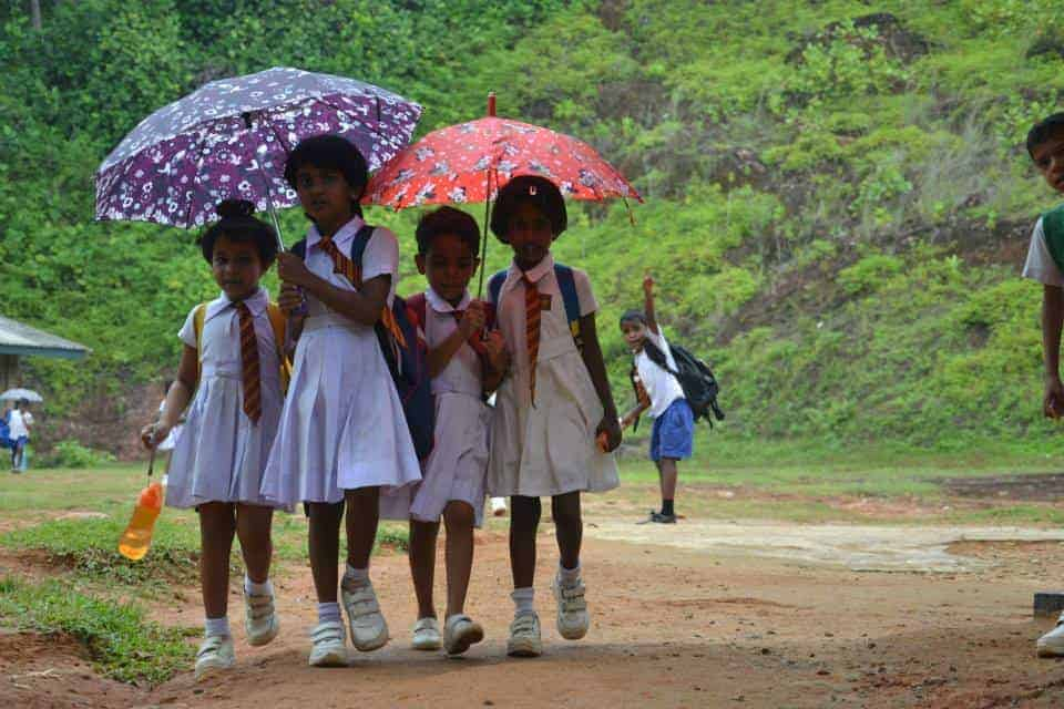 Schools kids with their umbrellas