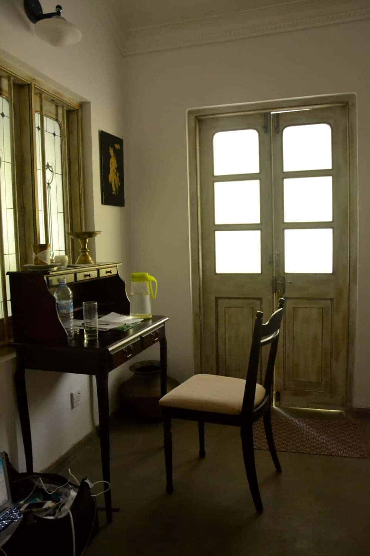 Room desk with a jar and glass of water in Plantation Villa Resort in Kalutara-Sri Lanka.