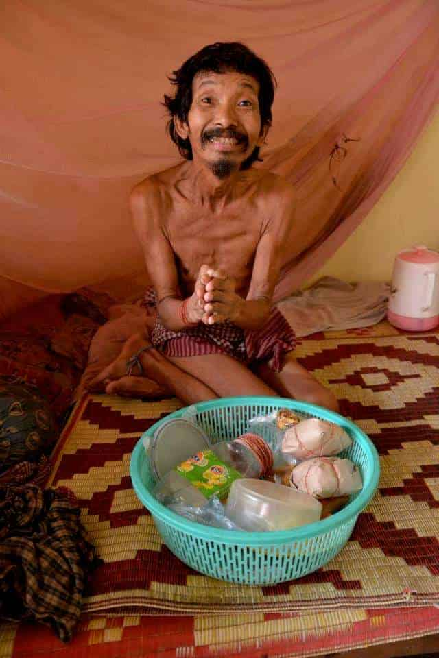 Poor man in village of siem reap asking for food