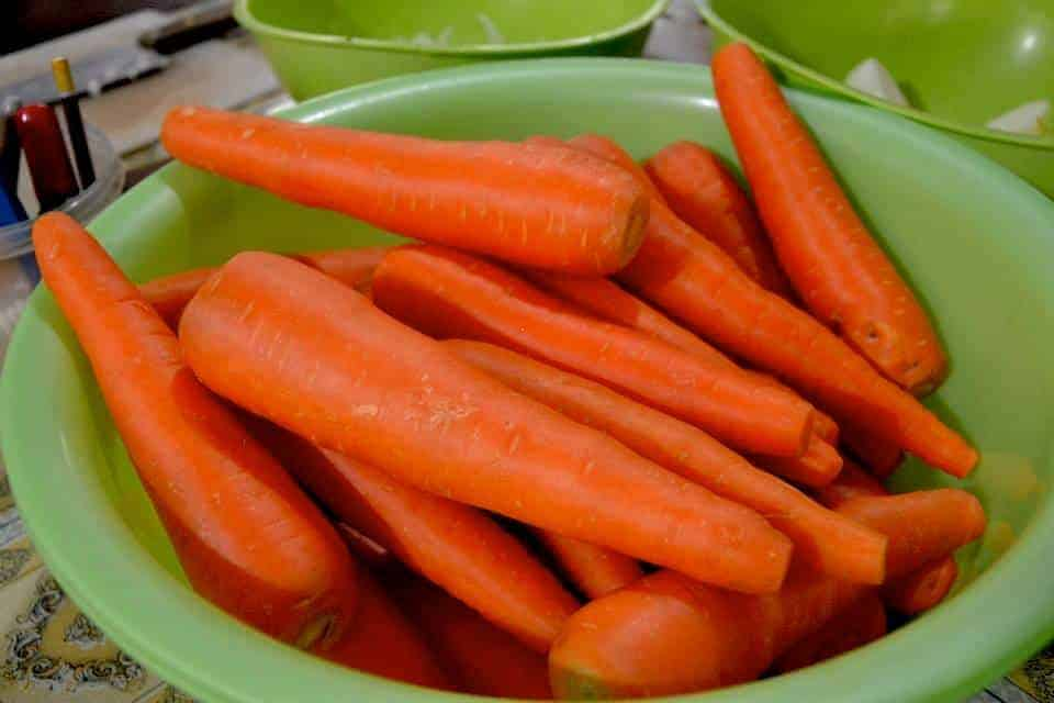 Carrots from market in a green bowl