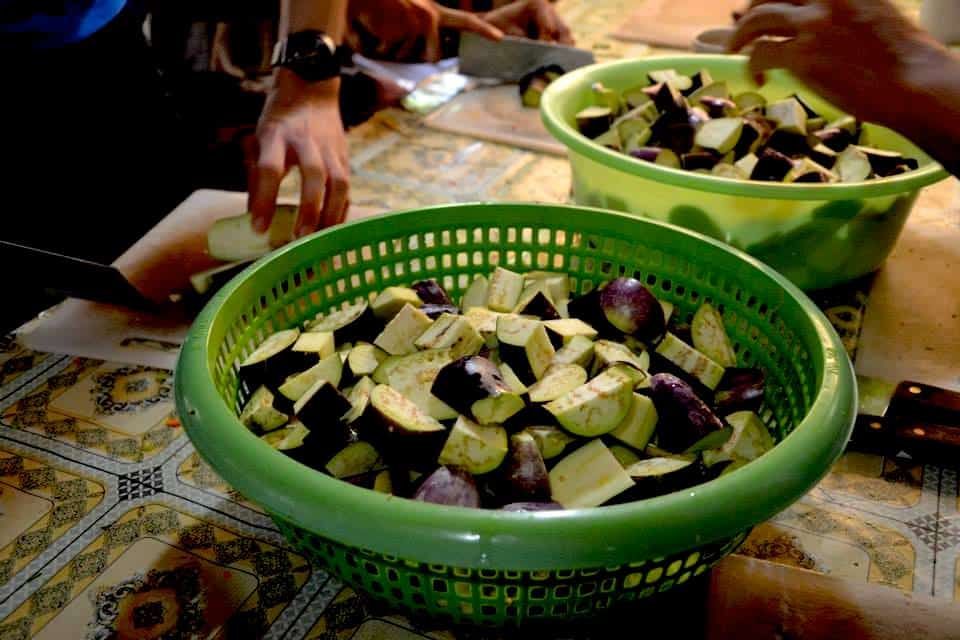Eggplant pieces in green bowls