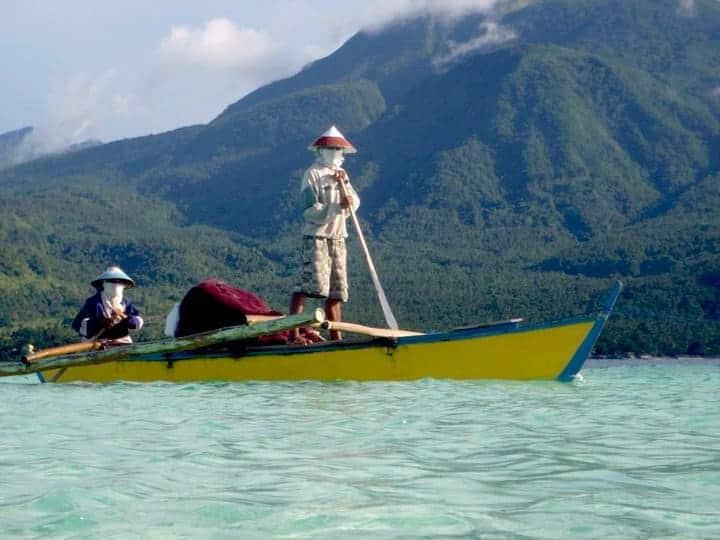 2 Fishermen inside a blue / yellow boat