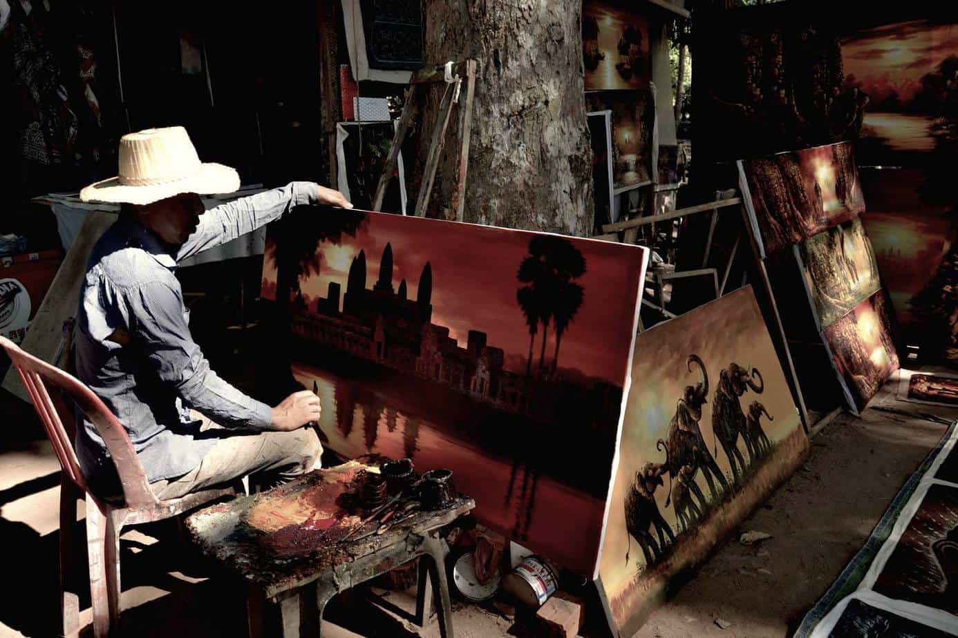 A man does a paint in Cambodia