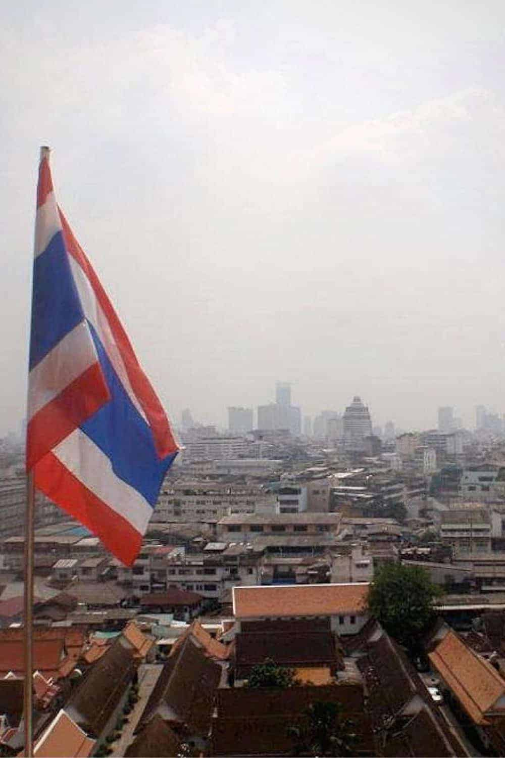 The Thai flag with a city view