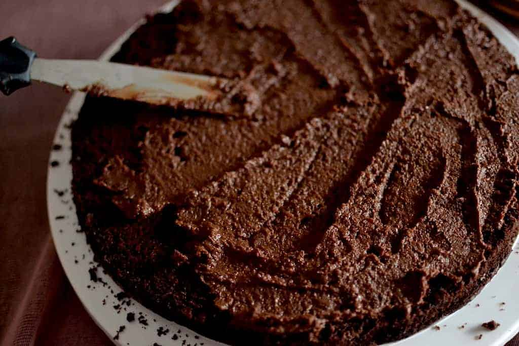 Spreading the Chocolate on the Peanut Butter Chocolate Cake