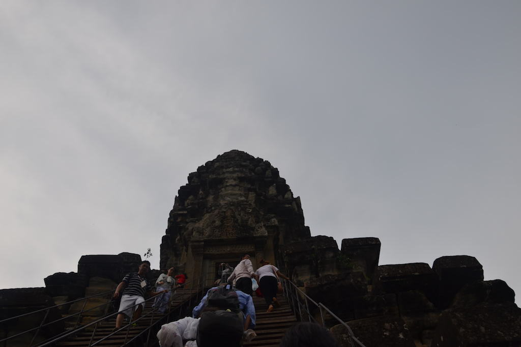 Climbing the stairs in Angkor Wat Temple