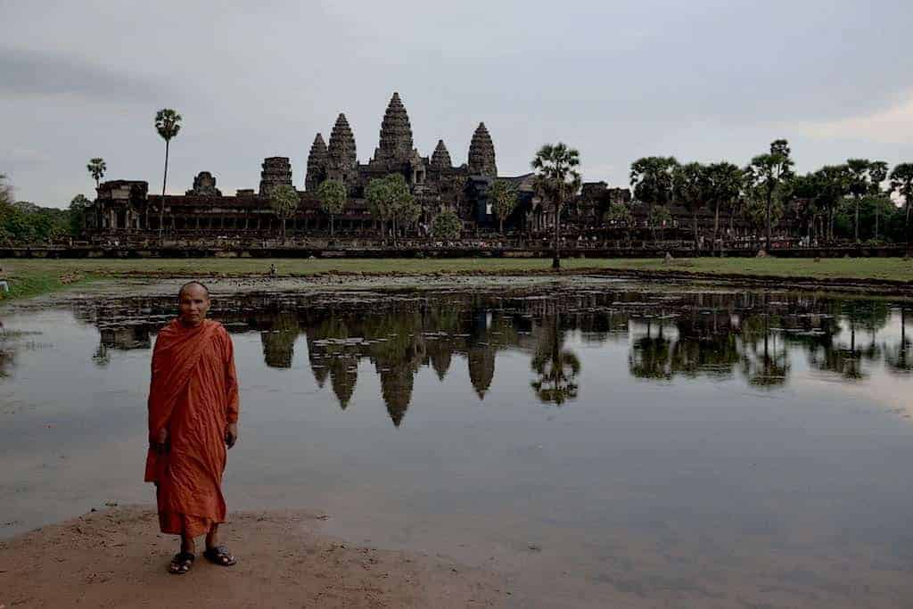 Monk posing for a photo in Angkor Wat Temple
