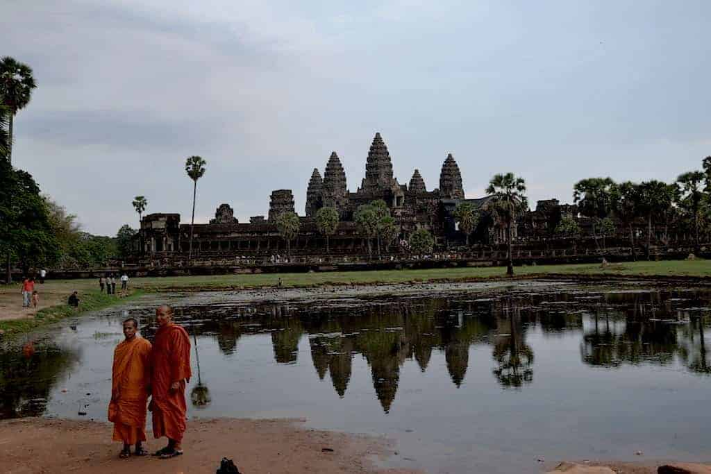 Monks are posing for a photo in Angkor Wat Temple