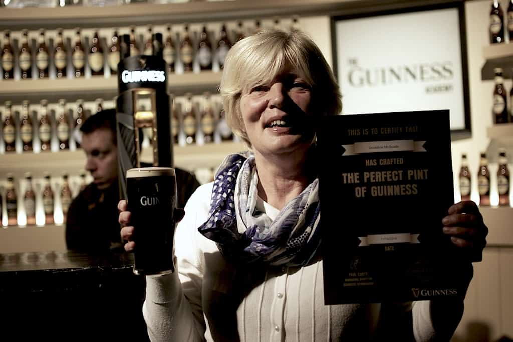 Guinness winner with a certificate