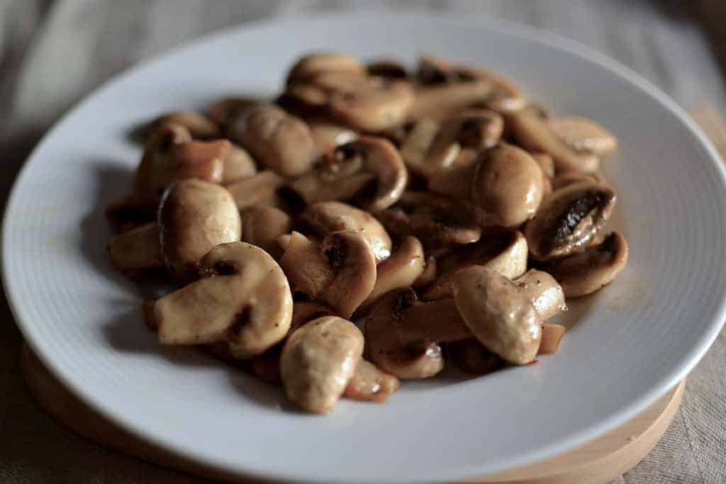 sauteed mushrooms in a white plate