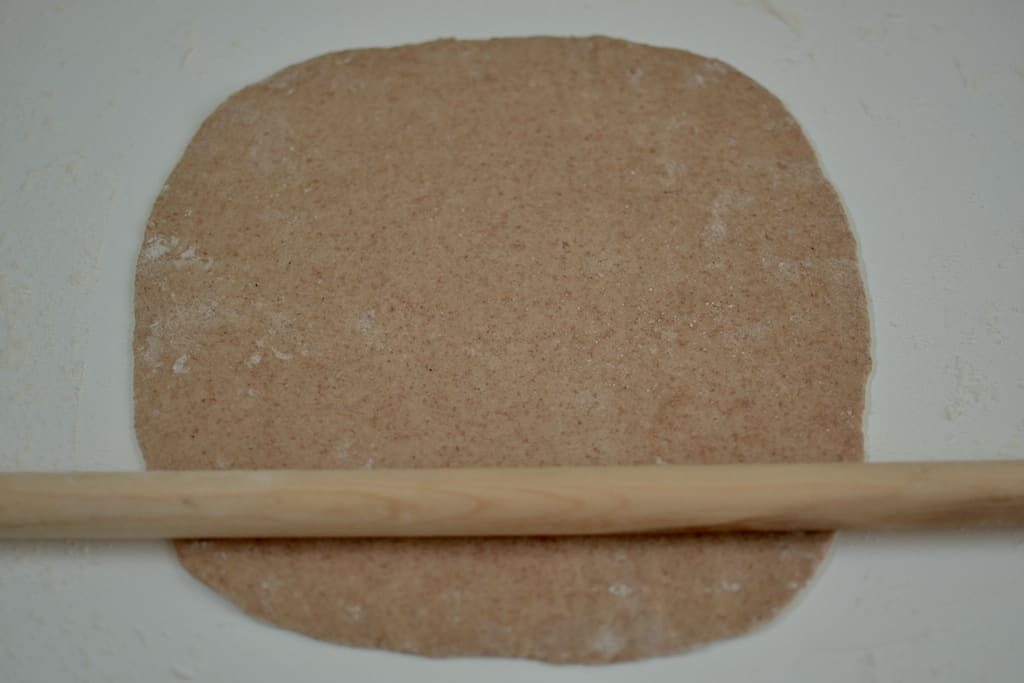 Greek Pita dough with a rolling pin