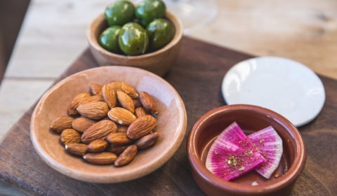 Almonds and Oils in white plates- Vegan Calcium (Sources and Recipes)
