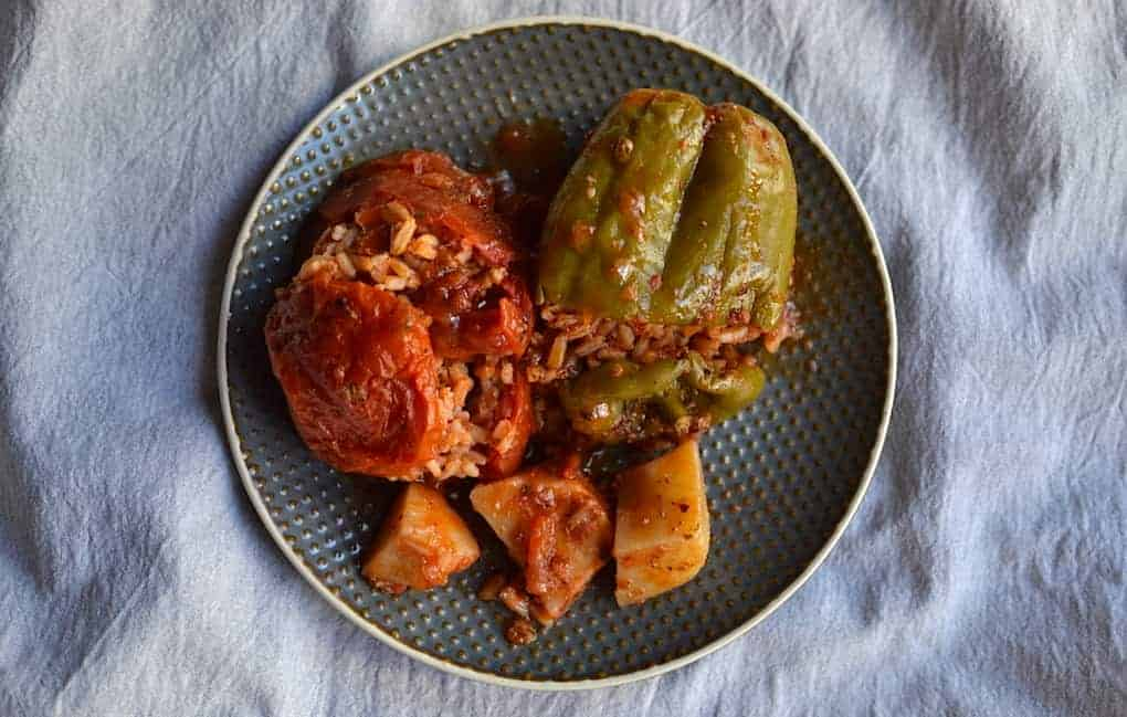 Stuffed tomato, pepper and potatoes in a grey plate