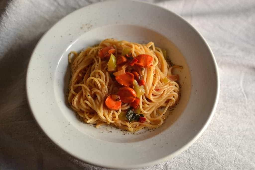 Pasta with tomato sauce in a white plate
