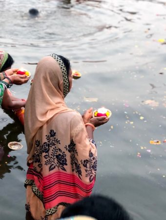 A woman is praying in Ganges River, Varanasi