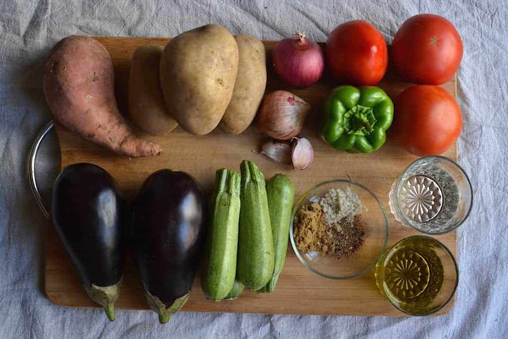 sweet potaotes. potatoes, tomatoes, eggplants, zucchini, water and spices