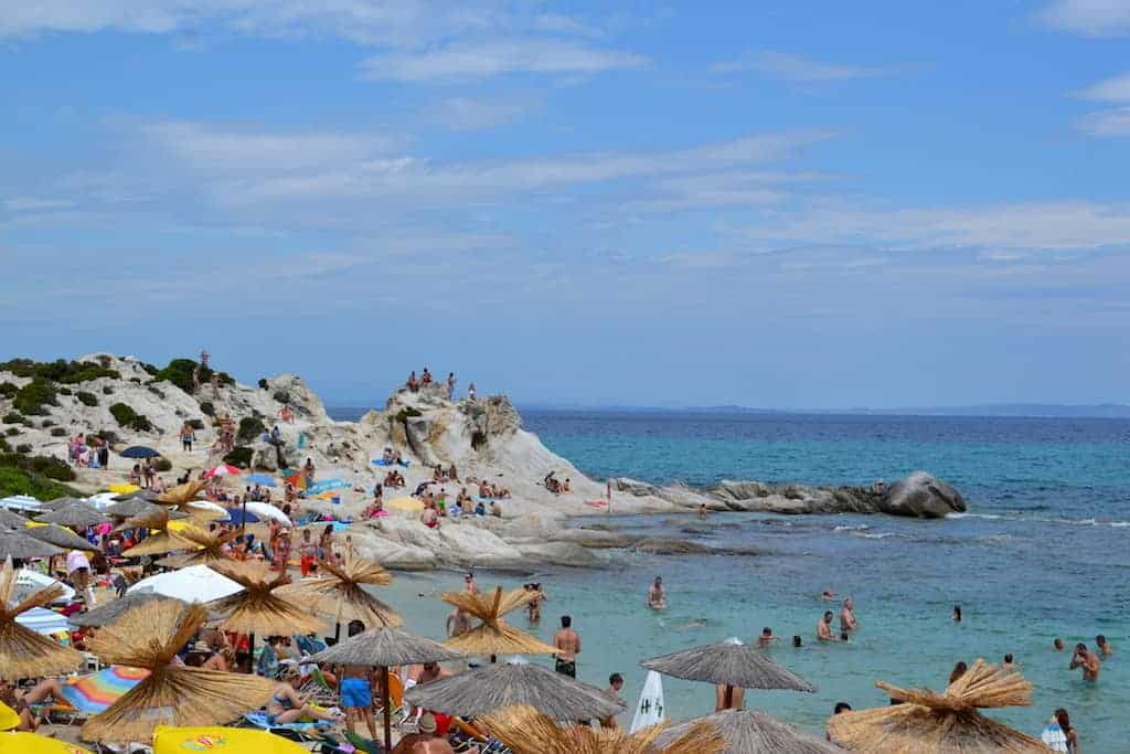 Halkidiki Beaches with lots of people and umbrellas