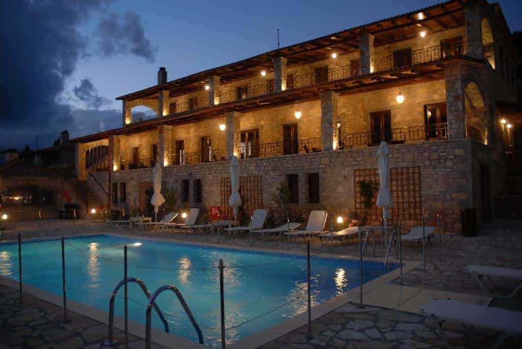 Omalia - village hotel at night with swimming pool