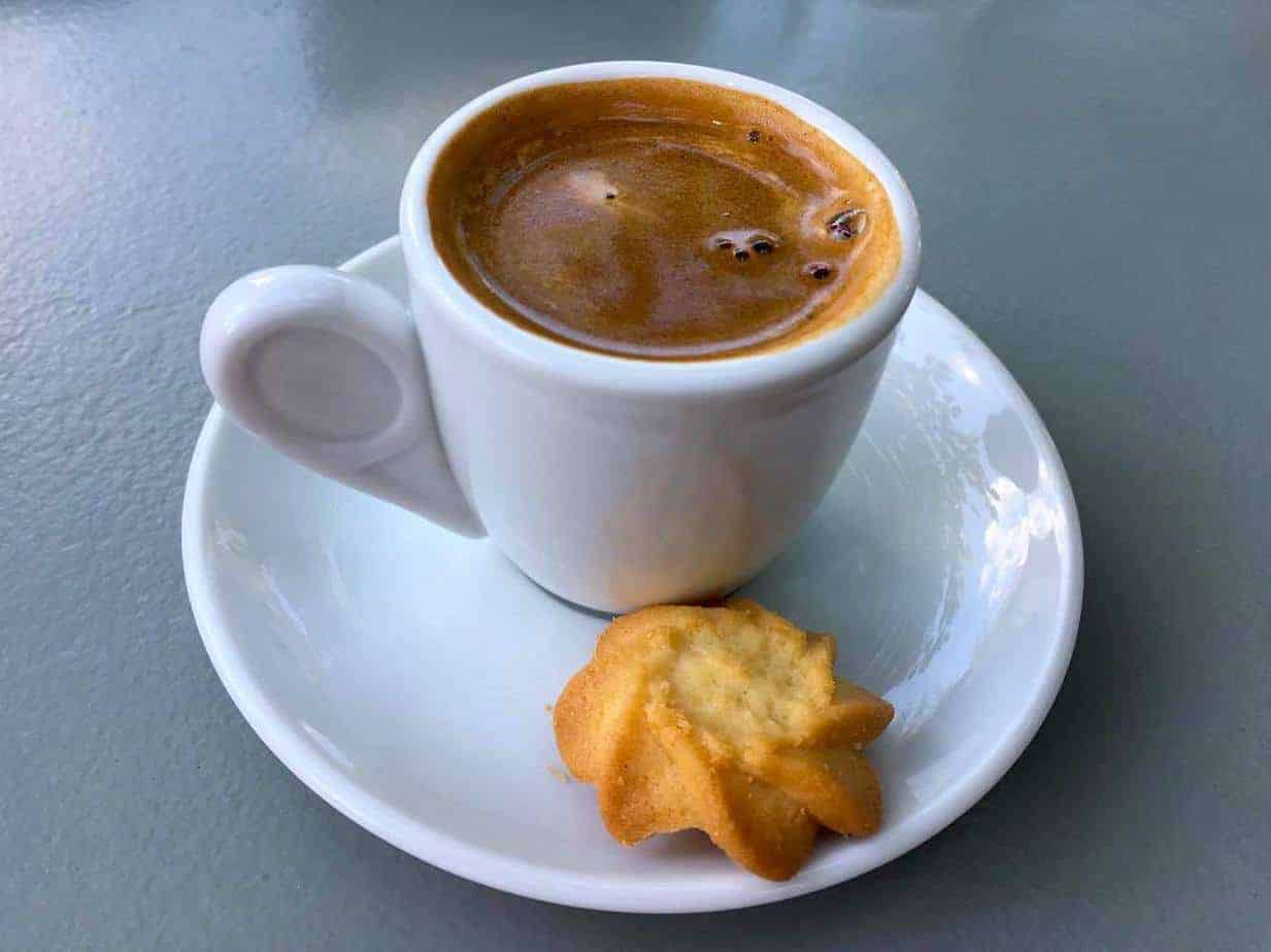 Greek coffee bliss with a cookie