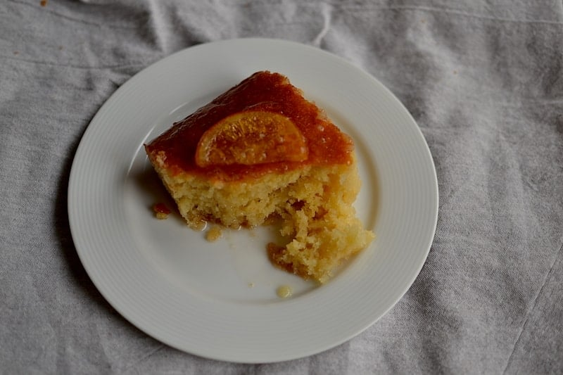 A piece of Greek orange pie in white plate