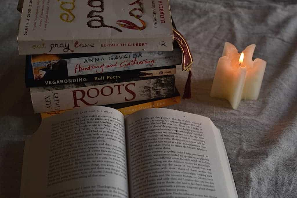 Wanderlust Books and a candle