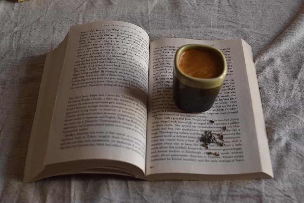 Coffee love with a travel open book
