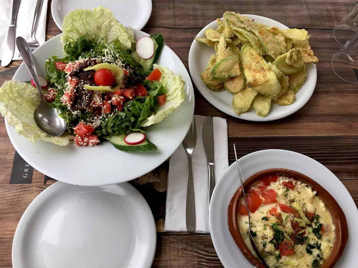 Dishes of Greek Salad and cheese dip