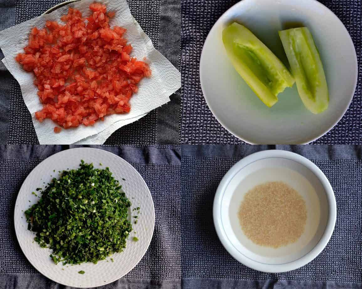 Tabbouleh Recipe ingredients. Tomatoes, cucumber, parsley, blugur
