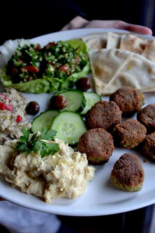 Arabic plate in middle east with tabouleh, hummus, falafel and moutabal