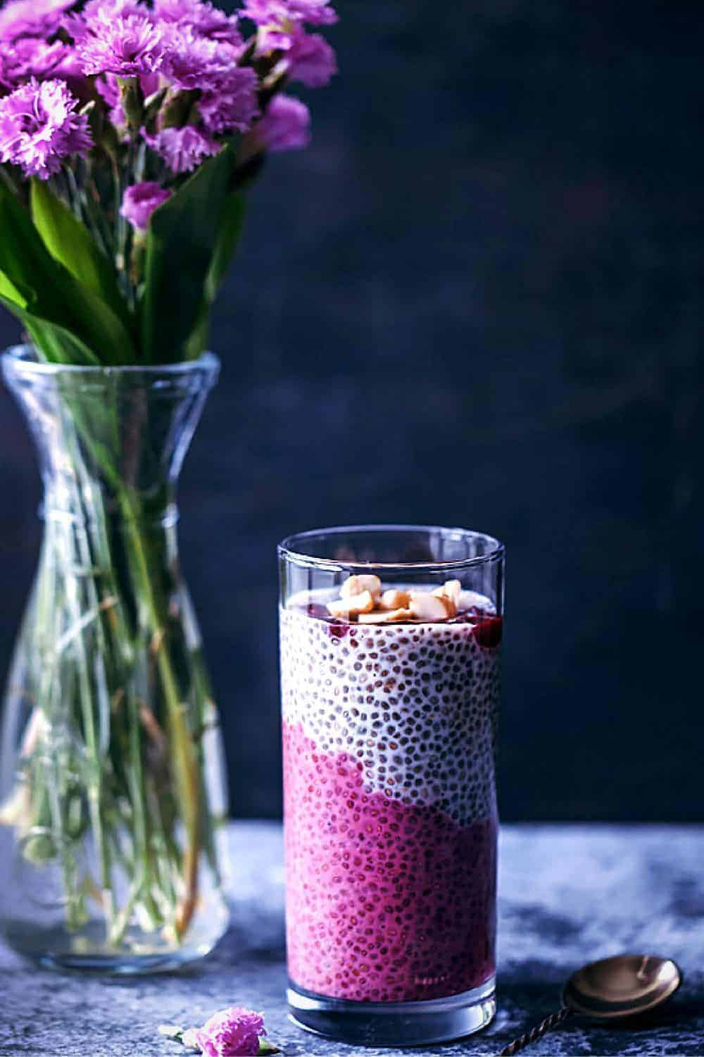 Pink chia smoothie with violet flowers