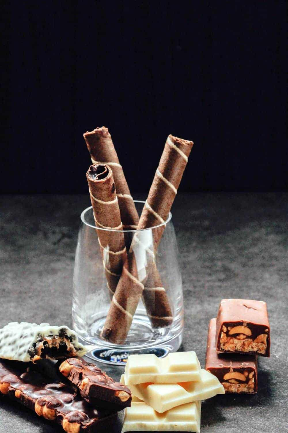 Cinnamon in a jar and pieces of back and white chocolate
