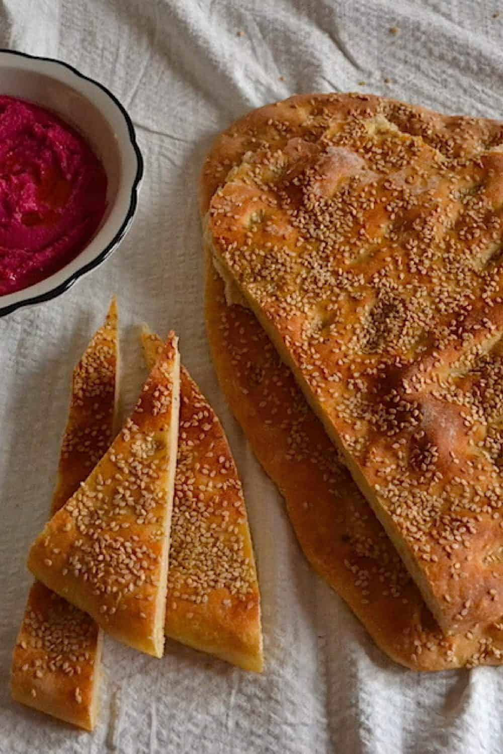 Greek Bread slices with beetroot hummus