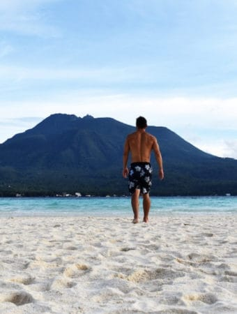 A man with a swimming suit in Camiguin Island in the Philippines
