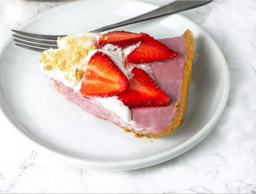 A piece of Strawberry cream pie topped with strawberries