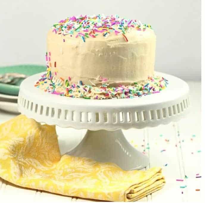 Funfetti White cake in a white cake stand.