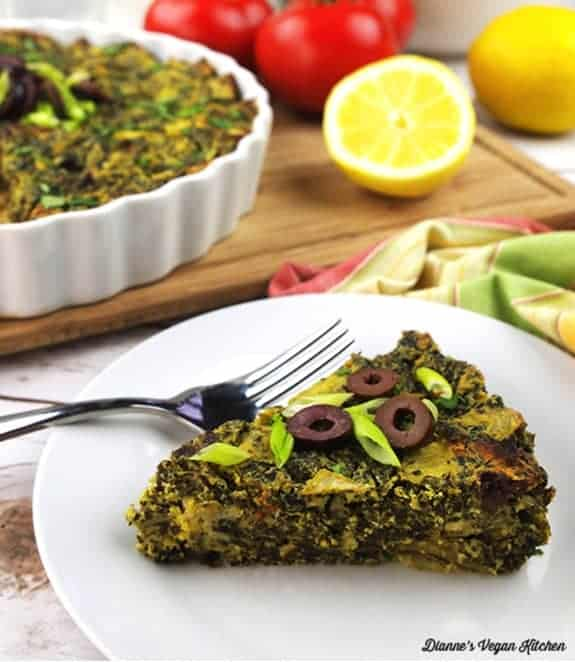 Vegan Greek Frittata in a whitwe plate with a fork - - Vegan Easter Recipes