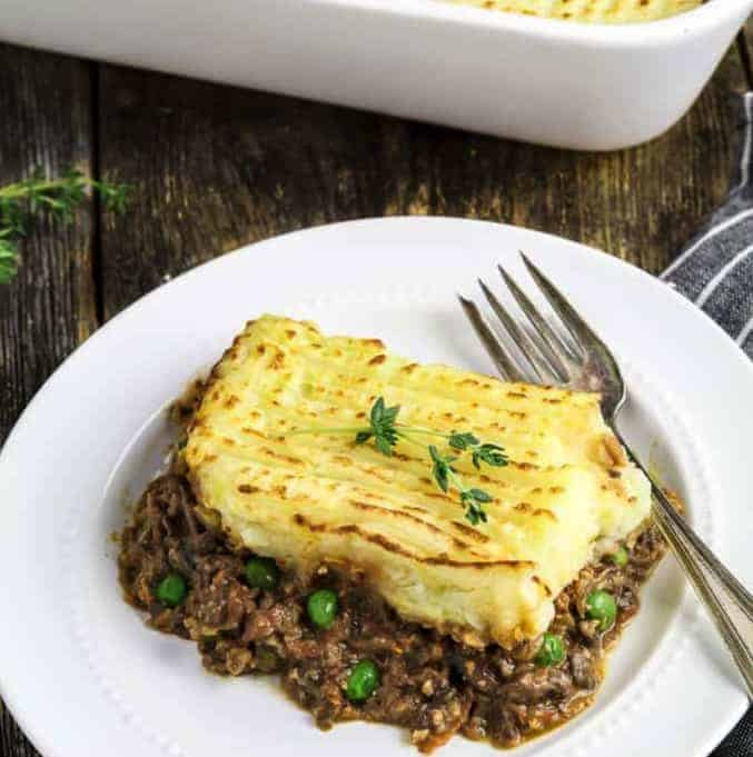 SHEPHERD'S PIE in a white plate with a fork - - Vegan Easter Recipes
