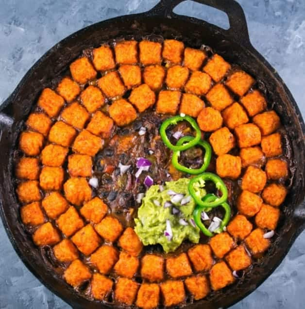 a pan with SWEET POTATO TATER TOT CASSEROLE (HOTDISH) - - Vegan Easter Recipes