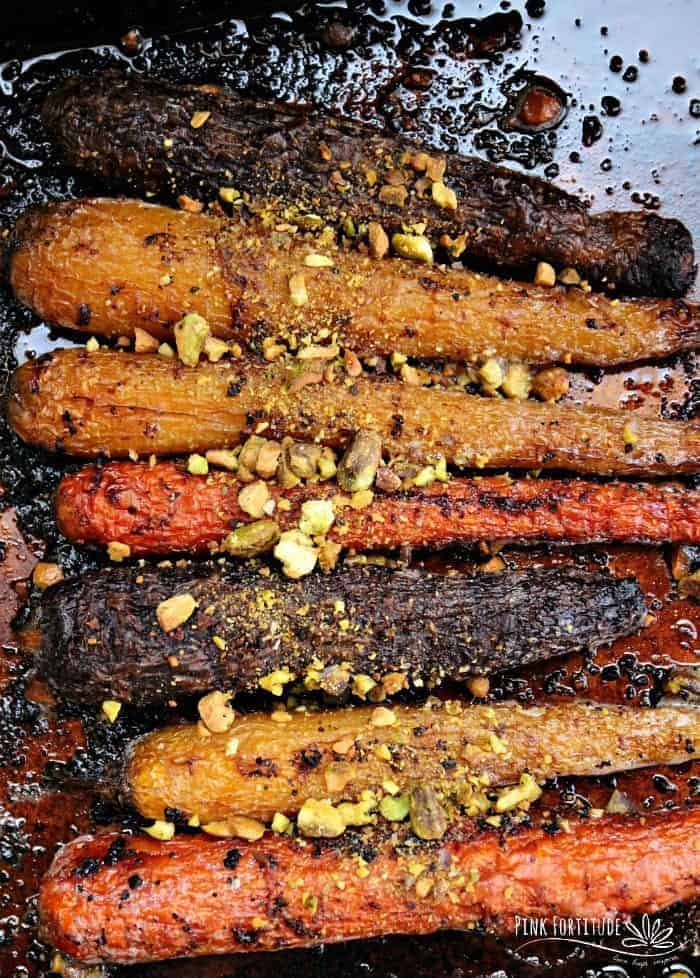 The Best Roasted Carrots in a brown pan - - Vegan Easter Recipes