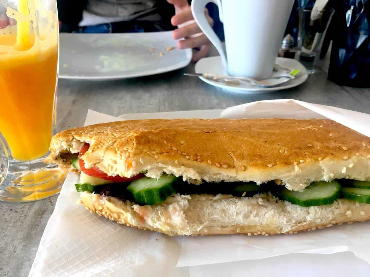 Vegetables sandwich with an orange juice