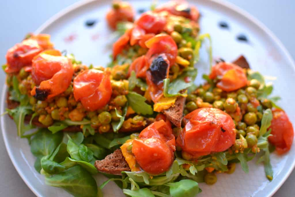 Bruschetta with peas in a white plate