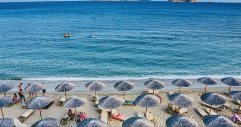 Greek beach with umbrellas