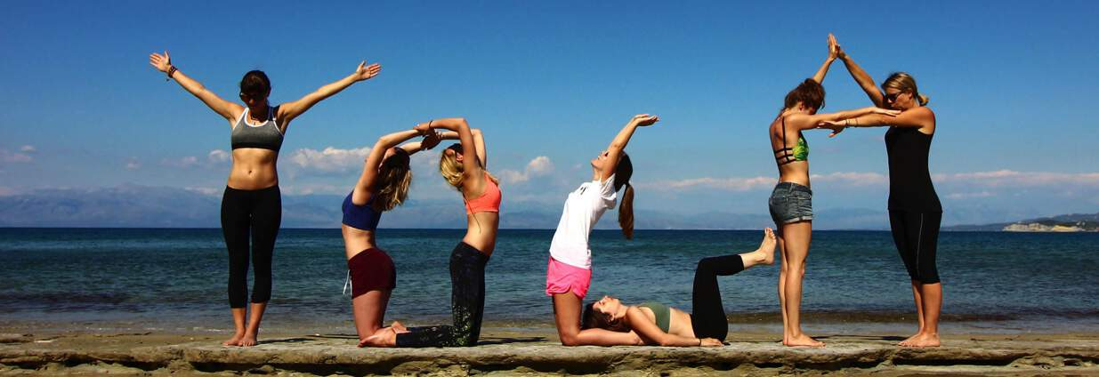 Yoga poses in the beach