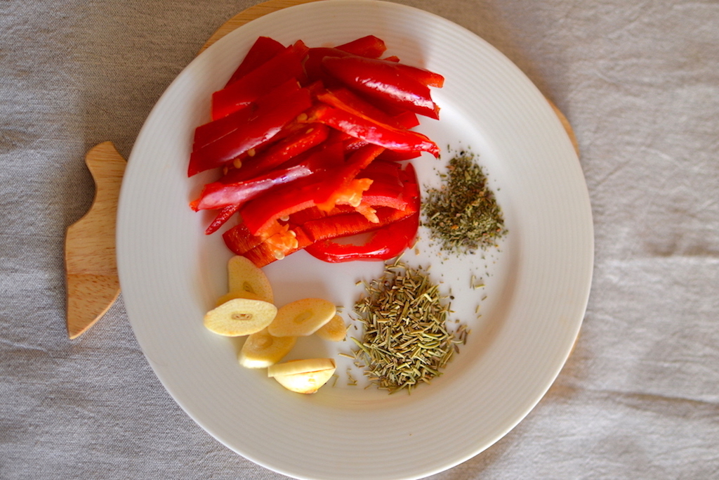 Sliced red peppers, spices and sliced garli