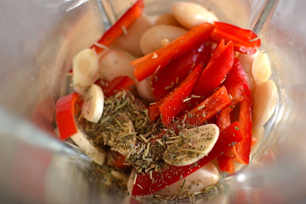 red peppers, spices and white beans in a blender