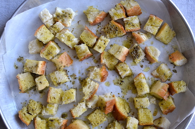 croutons with ollive oil in baking tray