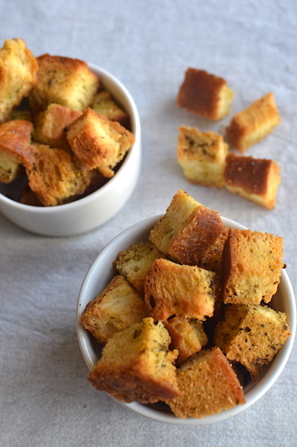 croutons in white bowls in a gey table