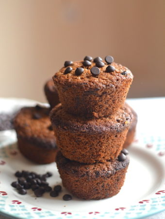 3 muffins one top of each other with chocolate