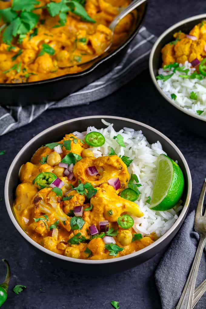 cauliflower curry with lime in mettalic bowl