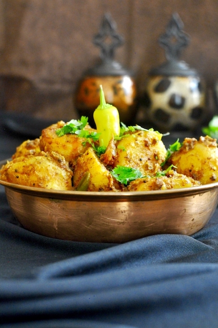 curry spiced baby potatoes in mettalic bowl